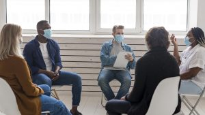 Group meeting practising social distancing